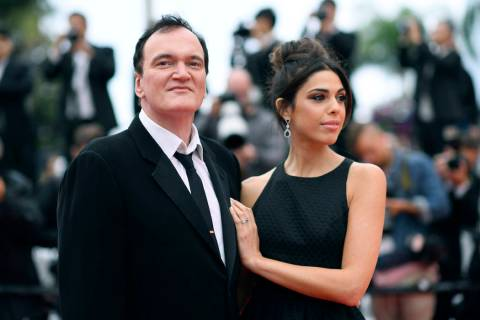 FILE - In this May 18, 2019 file photo, film director Quentin Tarantino and his wife Daniela Pi ...