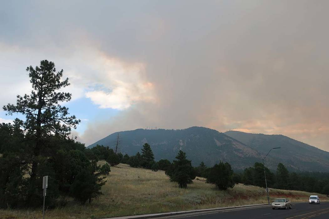Smoke rises Monday, July 22, 2019, from a wildfire burning in Flagstaff, Ariz. (AP Photo/Felici ...