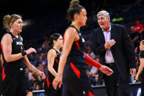Las Vegas Aces coach Bill Laimbeer, right, talks with his team during the first half of a WNBA ...
