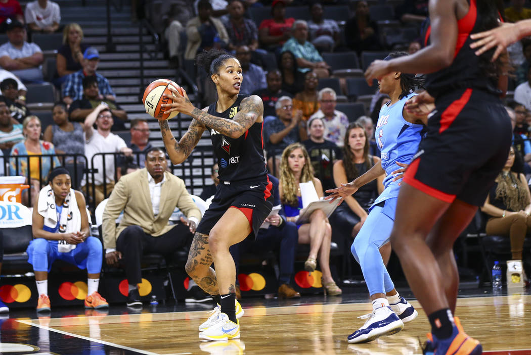 Las Vegas Aces' Tamera Young looks to pass the ball during the second half of a WNBA basketball ...