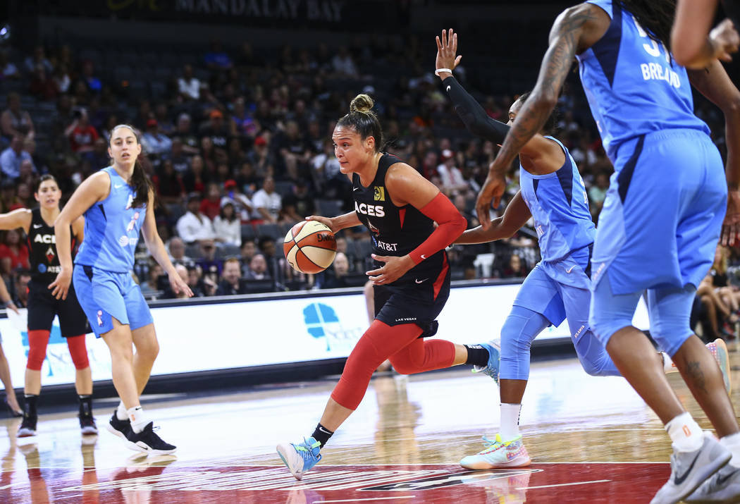 Las Vegas Aces' Kayla McBride drives to the basket past Atlanta Dream's Alex Bentley during the ...
