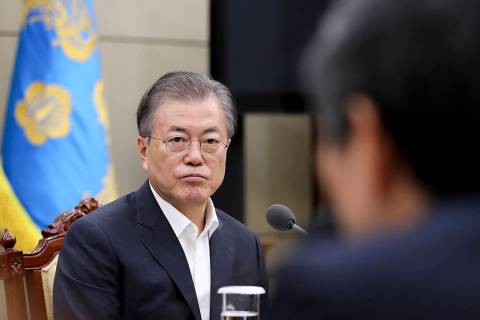 In this photo provided by South Korea Presidential Blue House, South Korean President Moon Jae- ...