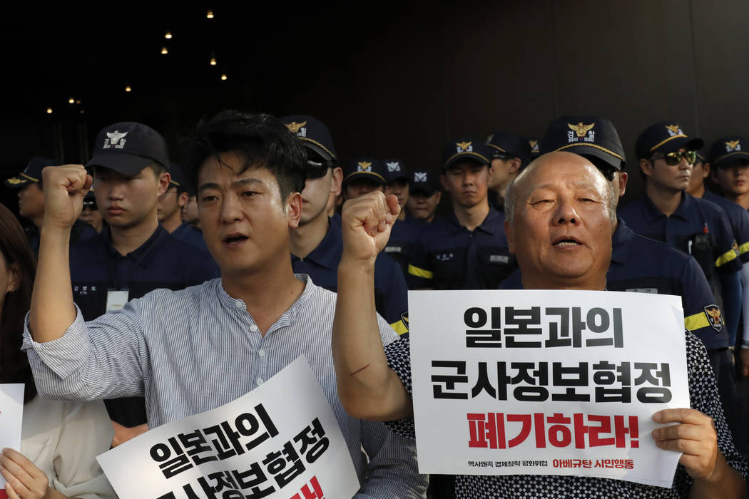 South Korean protesters shout slogans during a rally demanding the South Korean government to a ...