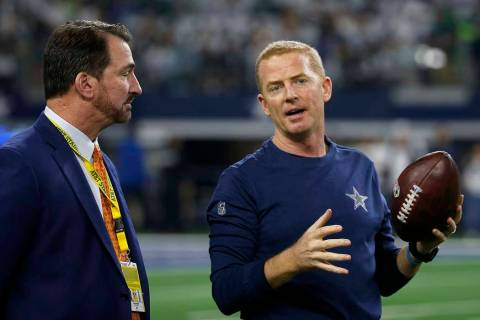 Broadcaster and former Dallas Cowboys quarter back Babe Laufenberg, left, and head coach Jason ...