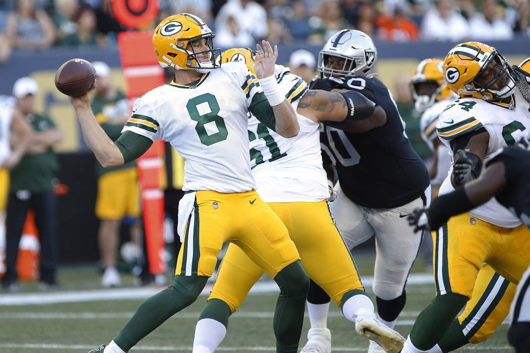 Green Bay Packers quarterback Tim Boyle (8) throws during the first half of the team's NFL pres ...