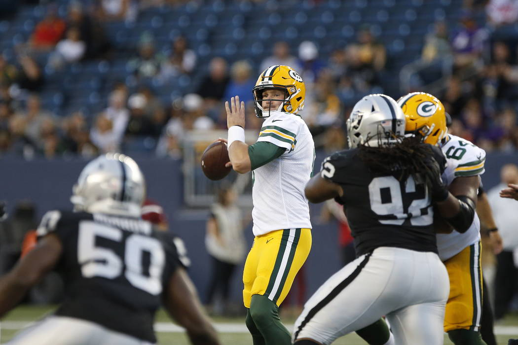 Green Bay Packers quarterback Tim Boyle looks for a receiver during the first half of an NFL pr ...