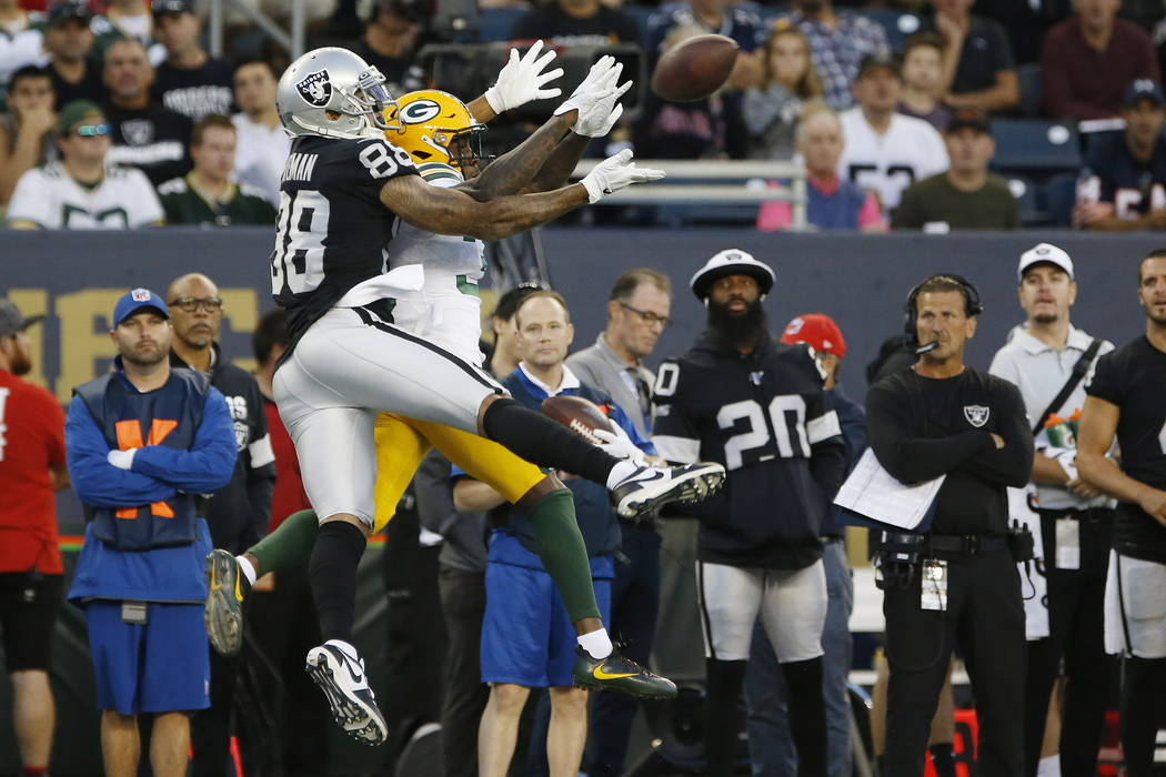 Oakland Raiders' Marcell Ateman (88) goes up for a pass as Green Bay Packers' Chandon Sullivan ...