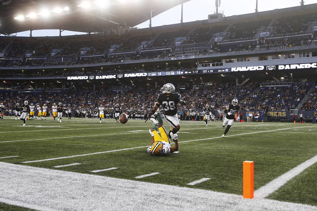 Green Bay Packers' Equanimeous St. Brown (19) misses the pass in the modified end zone as Oakla ...