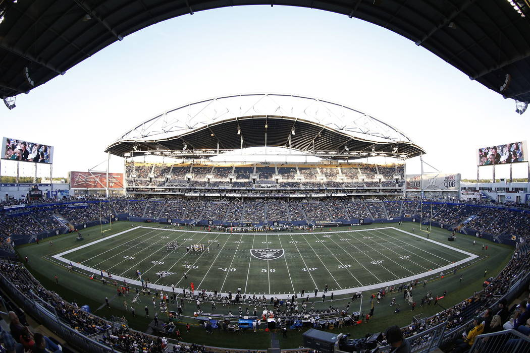 The Oakland Raiders and the Green Bay Packers play during the first half of an NFL preseason fo ...