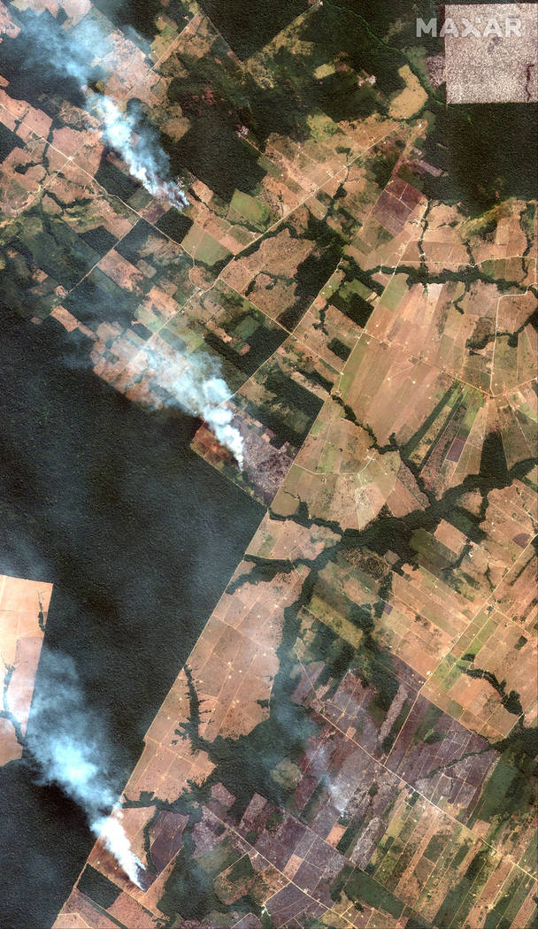This Aug. 15, 2019 satellite image from Maxar Technologies shows overview of fires southwest of ...