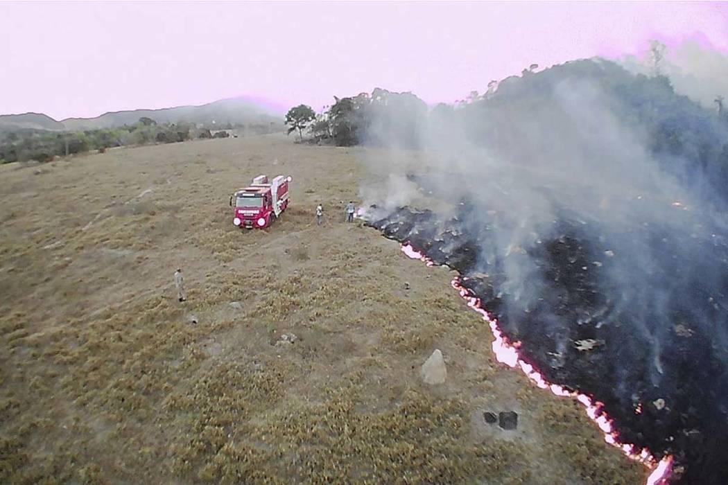 In this Aug. 20, 2019 drone photo released by the Corpo de Bombeiros de Mato Grosso, brush fire ...
