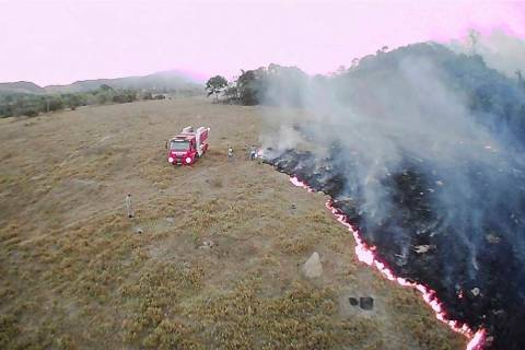 In this Aug. 20, 2019 drone photo released by the Corpo de Bombeiros de Mato Grosso, brush fire ...