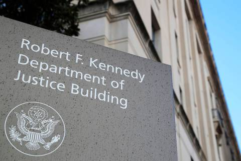 FILE - This Friday, March 22, 2019, file photo shows the Department of Justice Building in Wash ...