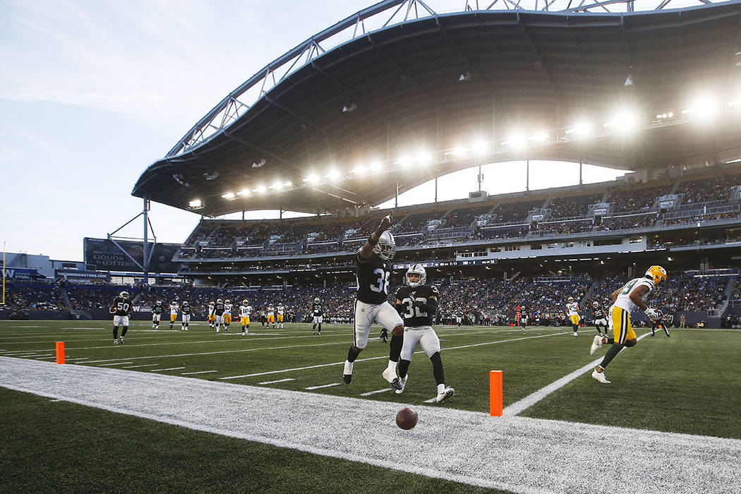 """Oakland Raiders' Keisean Nixon (38) celebrates after knocking away a pass in the """"end zone"""" int ..."""