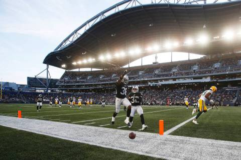 "Oakland Raiders' Keisean Nixon (38) celebrates after knocking away a pass in the ""end zone"" int ..."