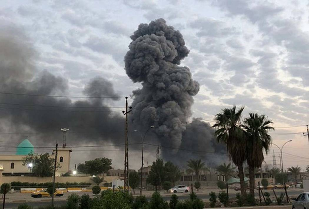 A Monday, Aug. 12, 2019, photo shows plumes of smoke rising after an explosion at a military ba ...