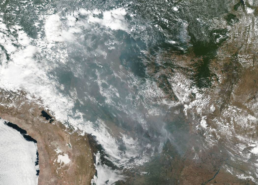 This satellite image provided by NASA shows the fires in Brazil on Aug. 20, 2019. As fires ra ...
