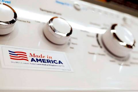 A May 9, 2019, file photo shows a General Electric washing machine with a label advertising it ...