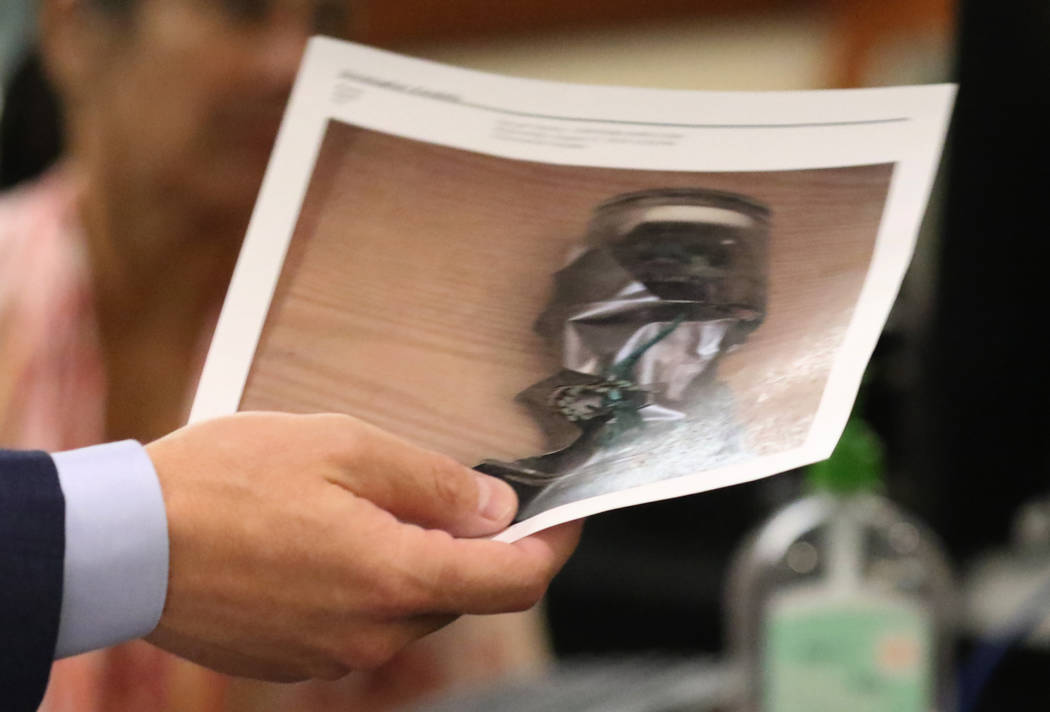 Prosecutor Christopher Pandelis holds a photograph of a homemade explosive device on Wednesday, ...