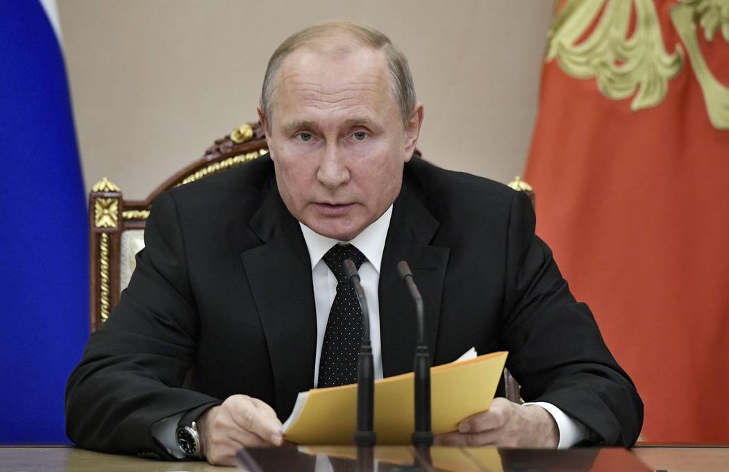 Russian President Vladimir Putin speaks at a meeting with members of the Security Council in th ...