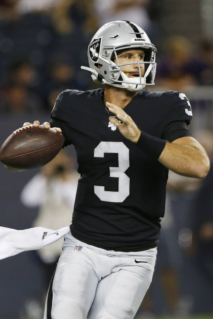 Oakland Raiders quarterback Nathan Peterman looks for a receiver during the second half of the ...