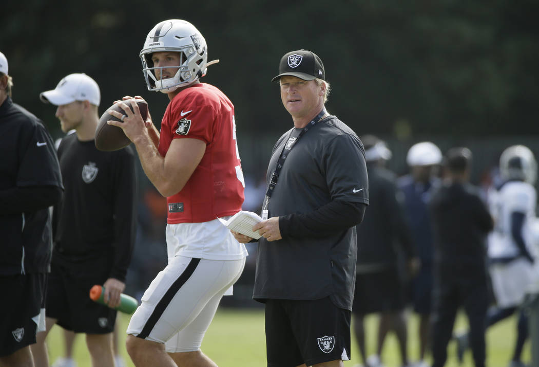 Oakland Raiders head coach Jon Gruden watches quarterback Nathan Peterman during NFL football t ...