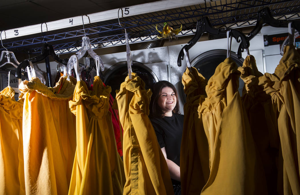 "Tyler Cecchini, a crafts technician for Cirque du Soleil's ""O,"" stands among costumes at the Be ..."