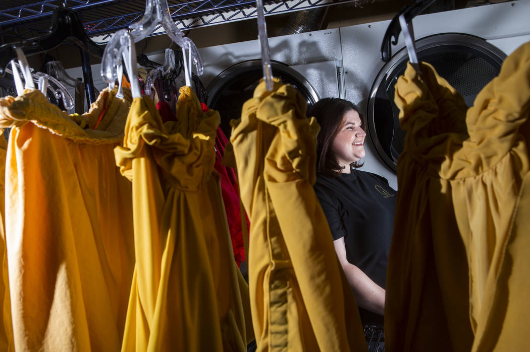 """Tyler Cecchini, crafts technician at Cirque du Soleil's """"O,"""" stands among costumes at the Bella ..."""
