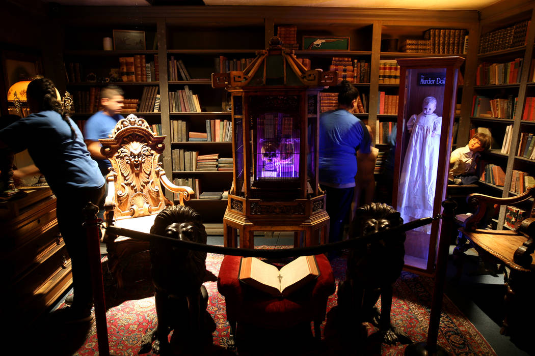 Clean Tastic workers do custodial work in the Library Room at Zak Bagans' Haunted Museum in dow ...