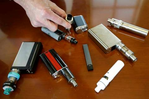 In this April 10, 2018 photo, Marshfield High School Principal Robert Keuther displays vaping d ...