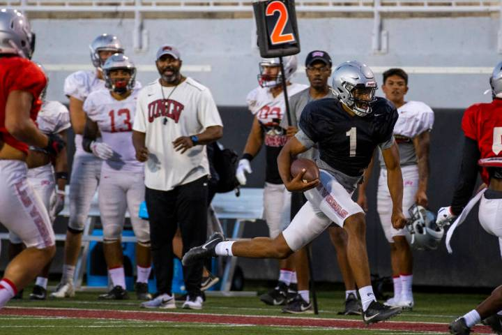 Quarterback Armani Rogers (1) streaks down the sidelines on a run during the UNLV football team ...