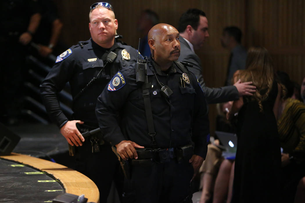 Clark County School District police officers keep watch during a heated CCSD board meeting to d ...