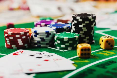 Poker chips on table in casino. (Getty Images)