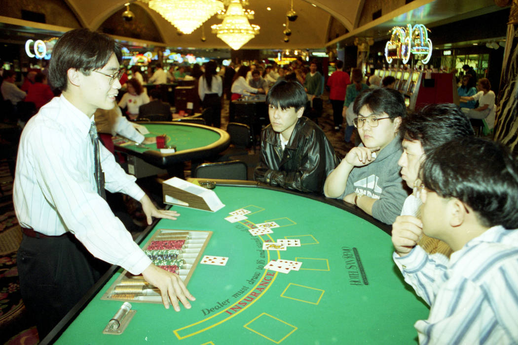In this 1994 file photo, San Remo Hotel instructor Keita Miyoshi explains blackjack to Akira Su ...