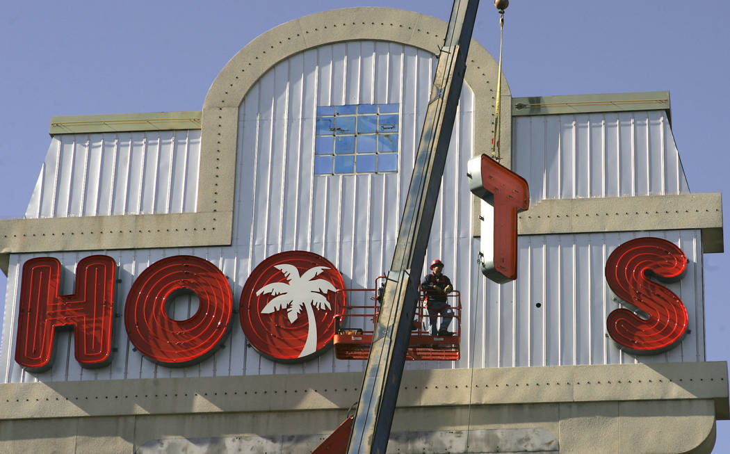 In this Feb. 1, 2006, file photo, the letters for the new marquee are raised into place at the ...