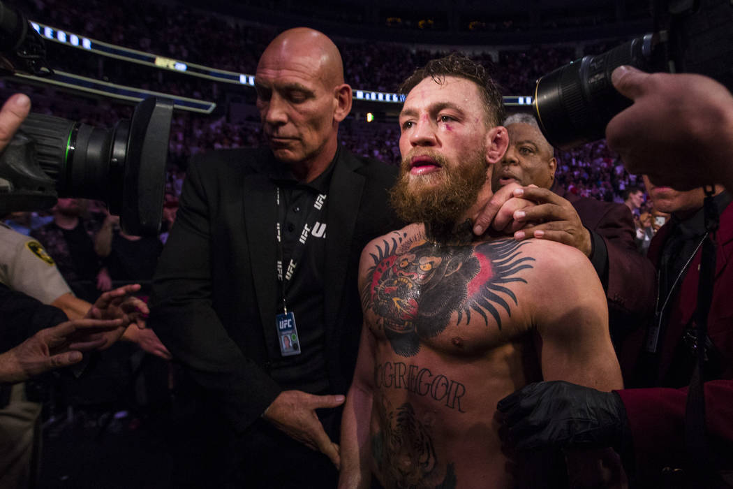 Conor McGregor leaves the octagon after his loss to Khabib Nurmagomedov in their lightweight ti ...