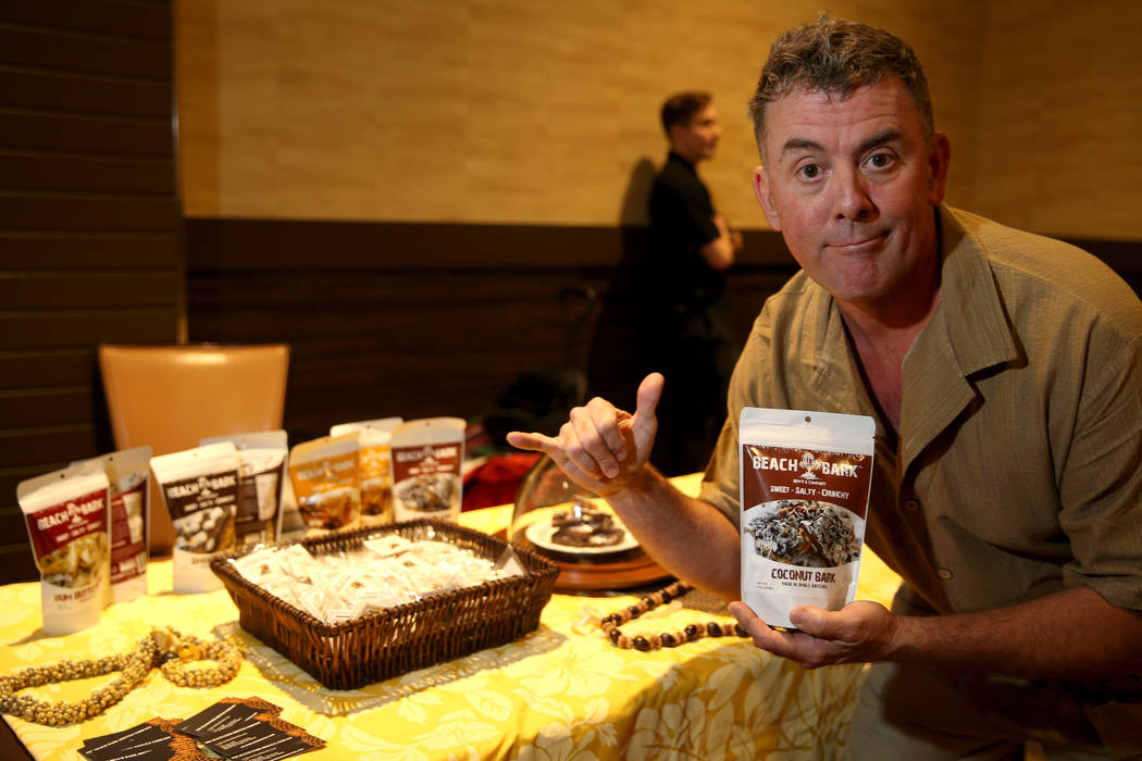 Christopher Campbell of The Beach Bark Brittle Company at his booth before the Start Tank entre ...