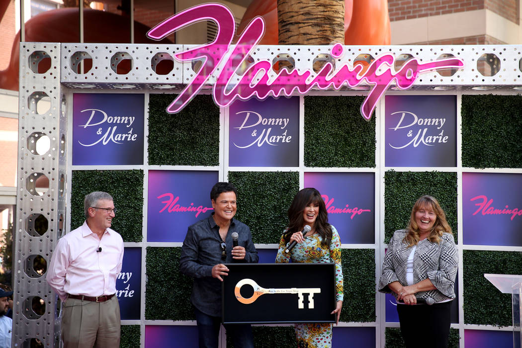 Strip headliners Donny and Marie Osmond receive a Key to the Strip as Caesars Entertainment CEO ...