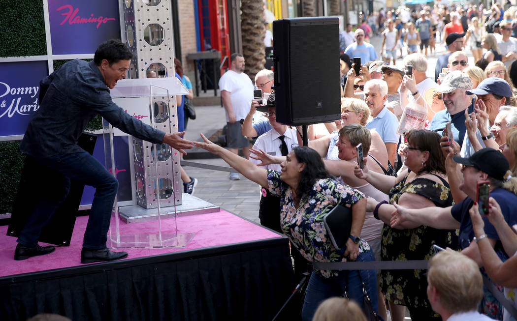Strip headliner Donny Osmond reaches out to fan Lucie Hanna of Canoga Park, Calif. after receiv ...