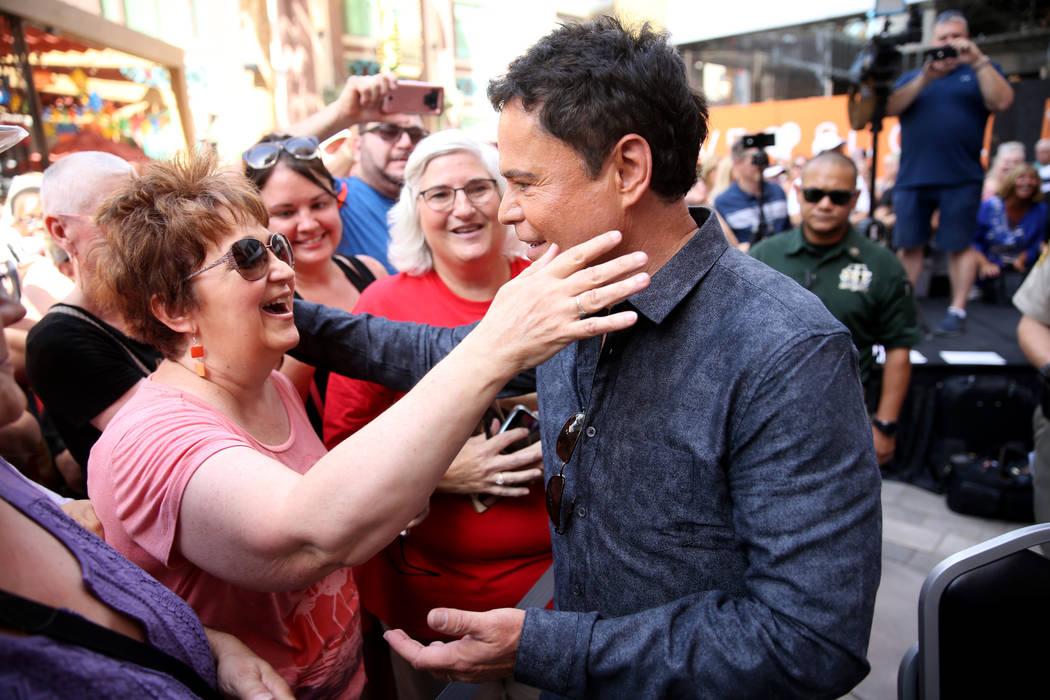 Strip headliner Donny Osmond hugs Elaine Swails of Orem, Utah after receiving a Key to The Las ...