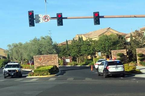 Police respond to the scene of a crash at Red Rock Ranch Drive and Sahara Avenue on Friday, Aug ...