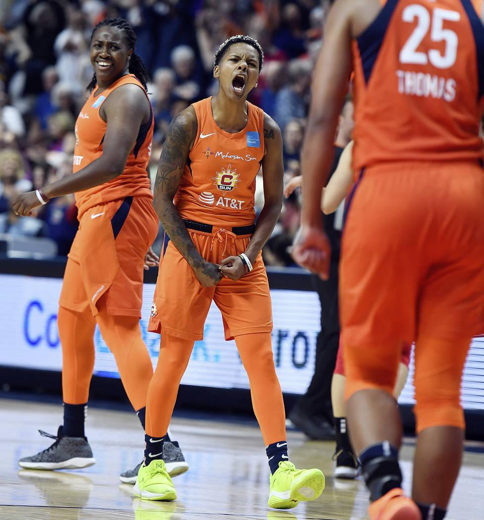 Connecticut Sun guard Courtney Williams, center, celebrates with teammates Shekinna Stricklen, ...