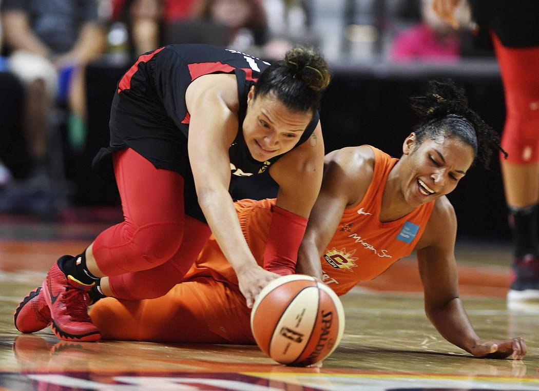Connecticut Sun forward Alyssa Thomas, right, and Las Vegas Aces guard Kayla McBride dive after ...