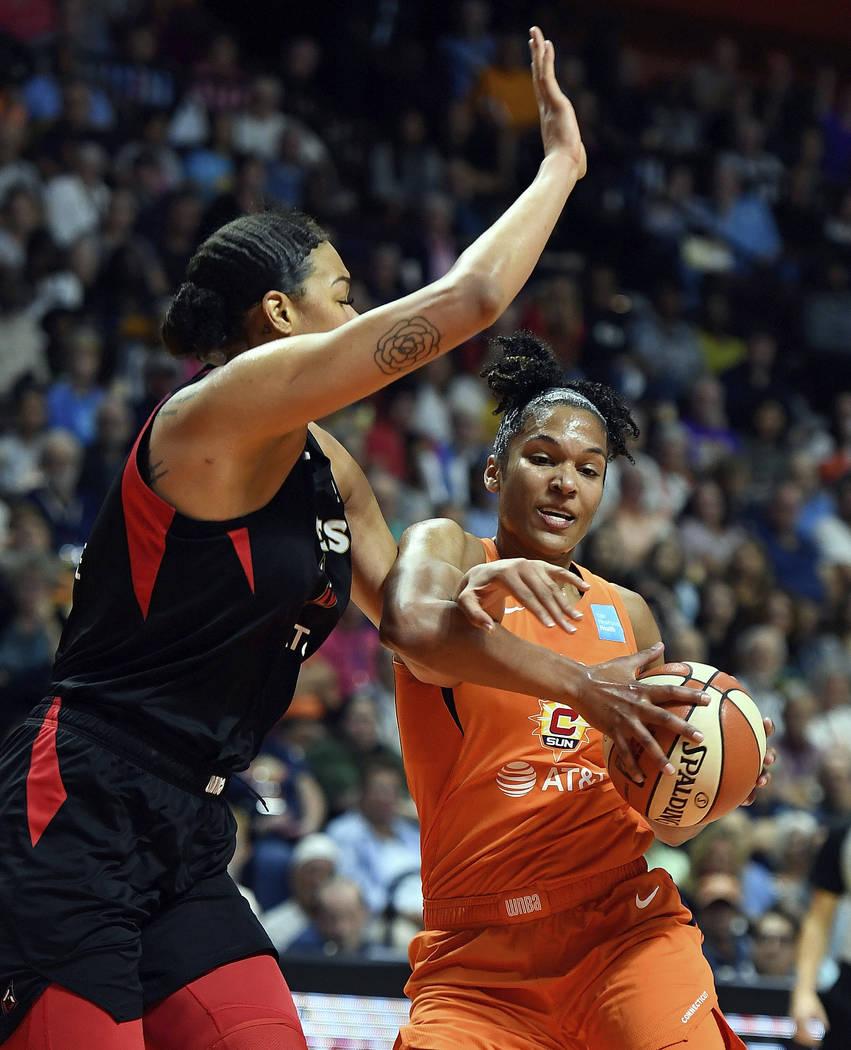 Connecticut Sun forward Alyssa Thomas, right, is fouled by Las Vegas Aces center Liz Cambage du ...