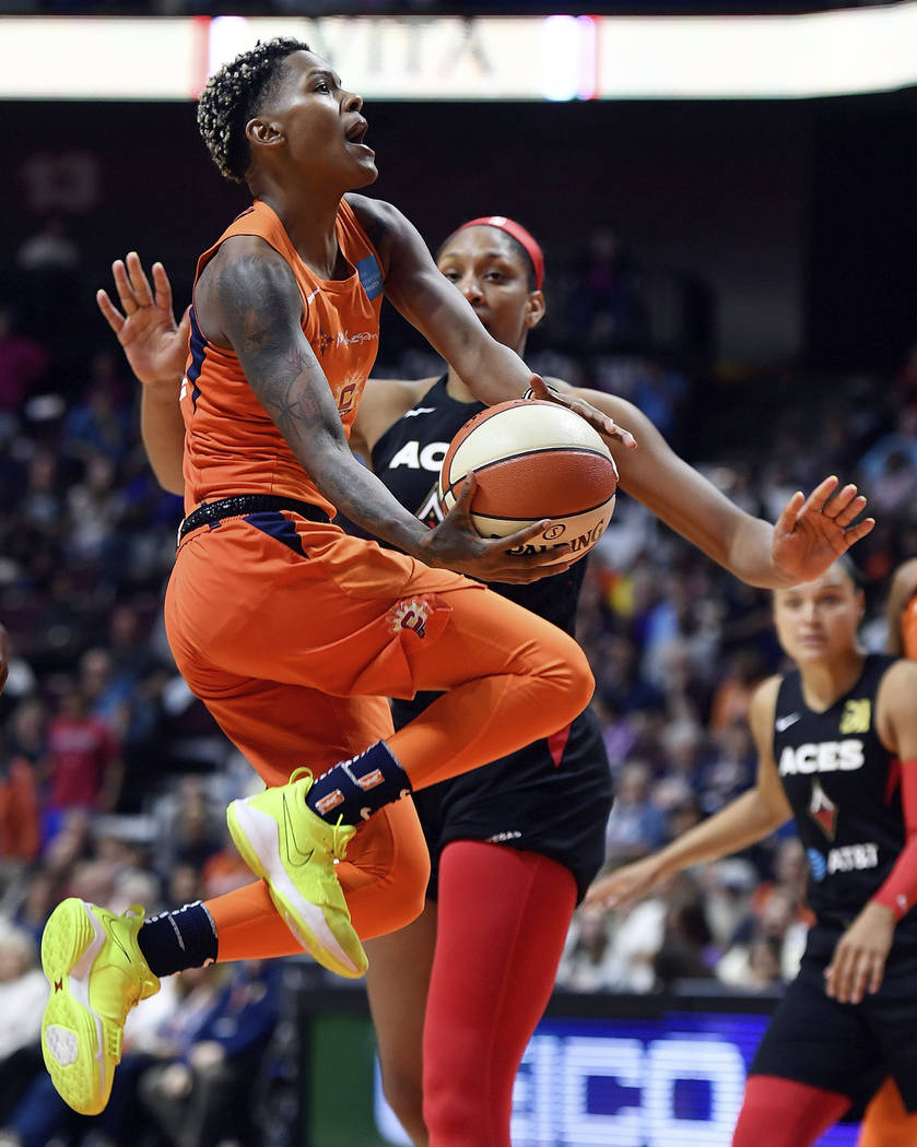 Connecticut Sun guard Courtney Williams puts up her shot as she is fouled by Las Vegas Aces for ...