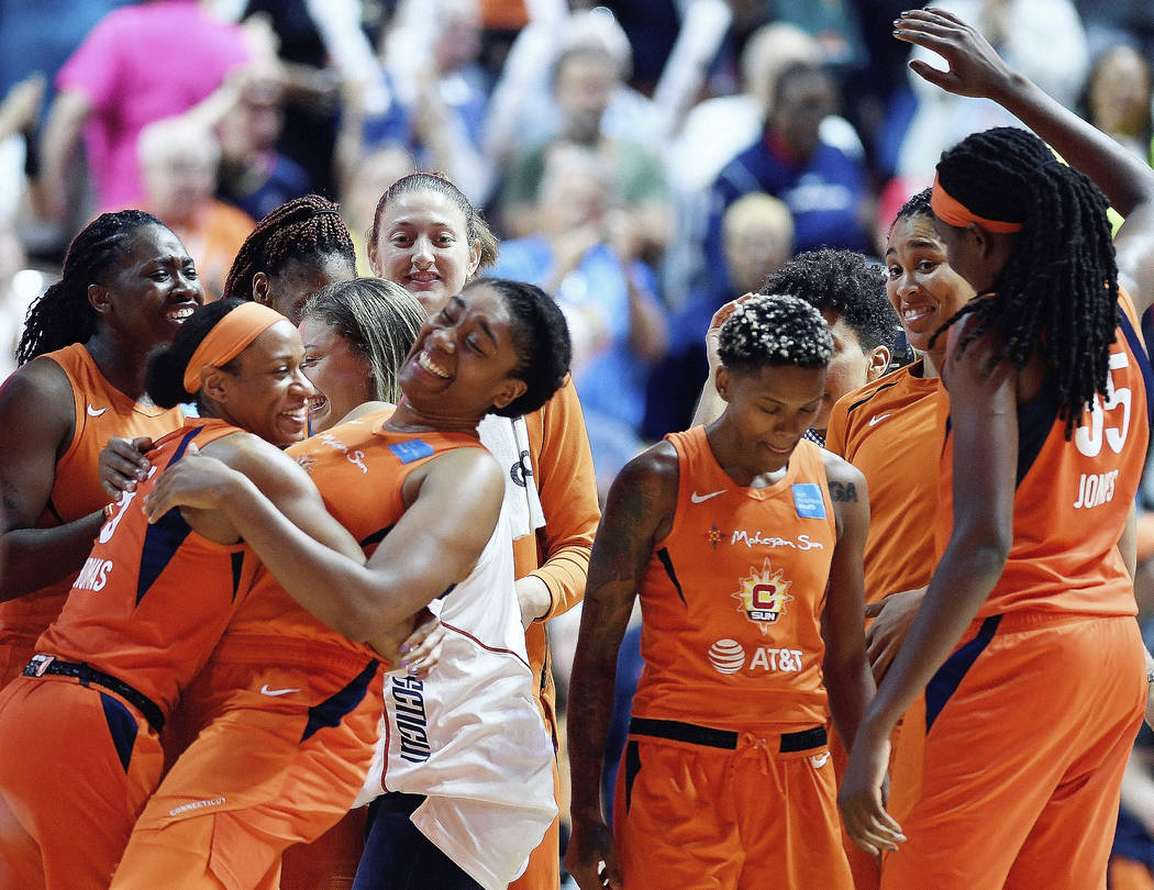 Connecticut Sun players celebrate a win over the Las Vegas Aces in a WNBA basketball game Frida ...