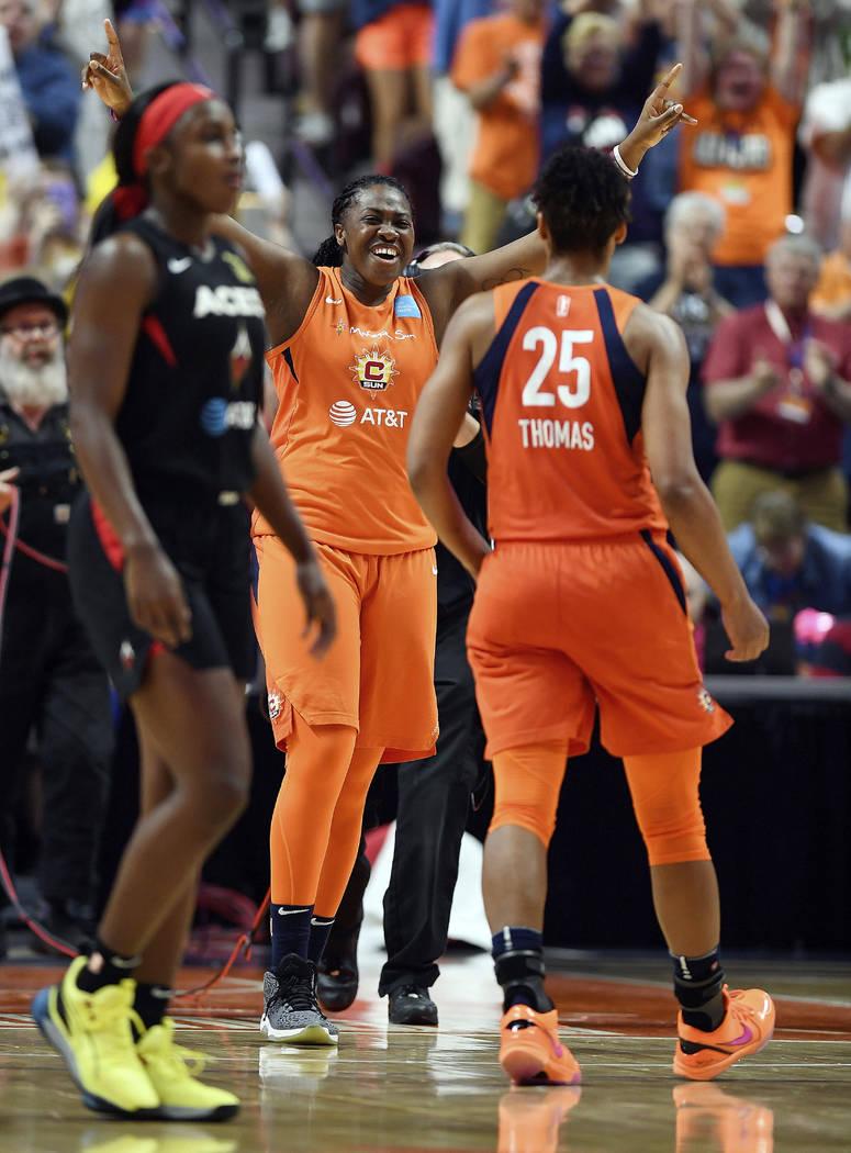 Connecticut Sun forward Shekinna Stricklen, center, celebrates with Alyssa Thomas, right, as La ...