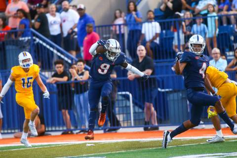 Bishop Gorman's Zachariah Branch (9) makes his way to the end zone to score a touchdown against ...