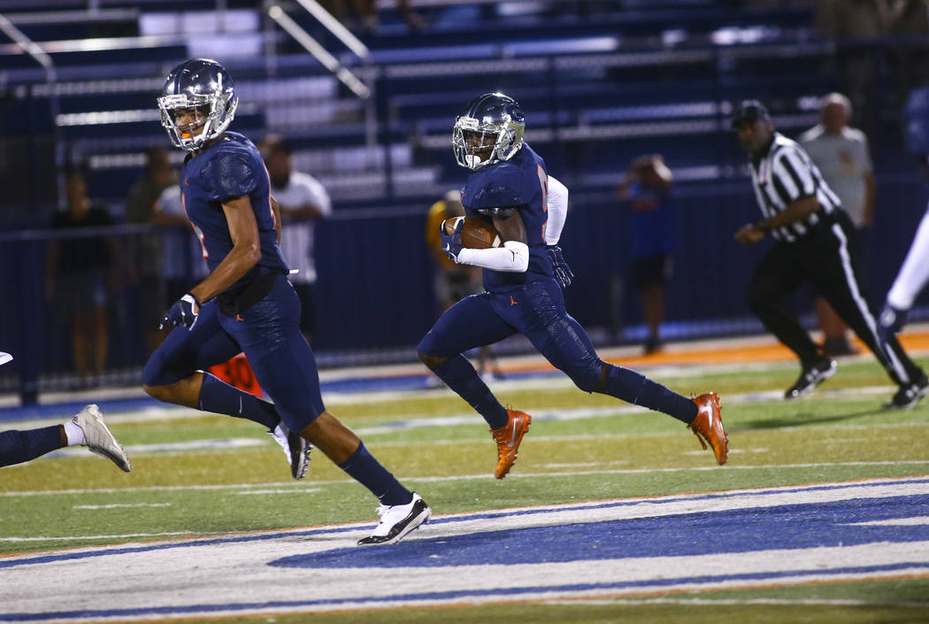 Bishop Gorman's Zachariah Branch (9) runs the ball against Orem during the first half of a foot ...
