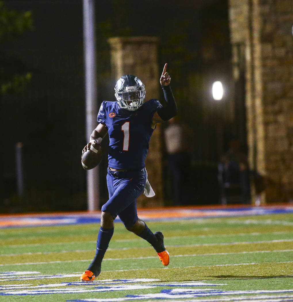 Bishop Gorman's Micah Bowens (1) motions to teammates during the first half of a football game ...